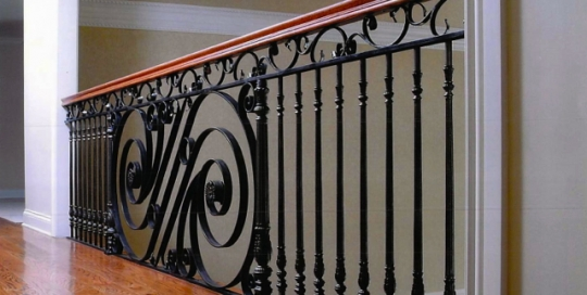 Finelli architectural iron and stairs custom hand forged iron balcony with wood railing cap in pepper pike ohio