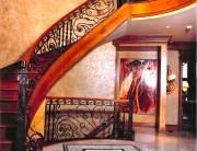 finelli ironworks handmade traditional style iron and wood staircase with forged scroll designs in waite hill ohio
