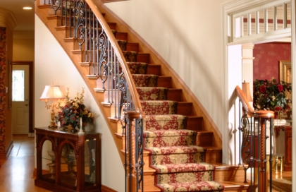 finelli iron works hand forged wrought iron balcony and staircase system with custom wood cap and scrolls in pittsburgh pennsylvania