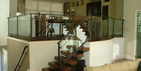 finelli iron custom handmade forged interior iron frame rail with glass panel inserts in hudson ohio