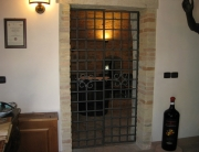 custom iron wine cellar door
