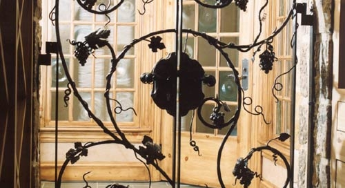 hand forged grape vine iron door