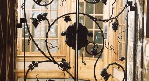 hand forged grape vine iron door