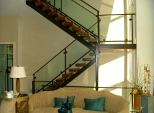 finelli ironworks custom modern design glass, wood, and steel staircase system with railing in cleveland ohio