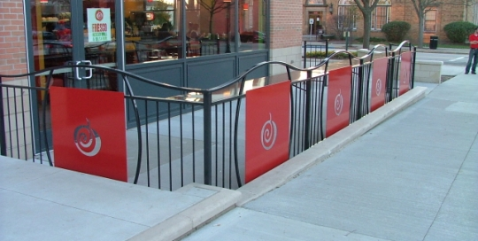 finelli architectural iron and stairs custom restaurant and outdoor seating fence with table top in cleveland ohio