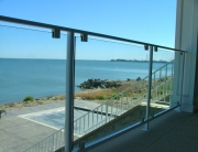 finelli architectural iron and stairs custom glass and iron panel balcony railing in put-in-bay- ohio