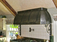 Finelli Architectural Iron and Stairs custom distressed stove hood handmade in northeast ohio