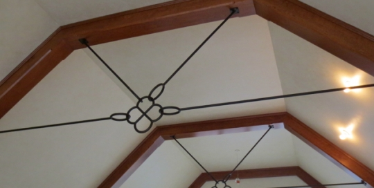 Finelli Architectural Iron and Stairs custom decorative interior iron tension bars in cleveland ohio