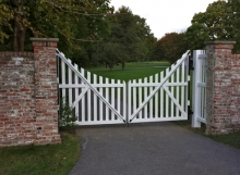 Finelli Architectural Iron and Stairs custom white wood driveway gate in bay village ohio