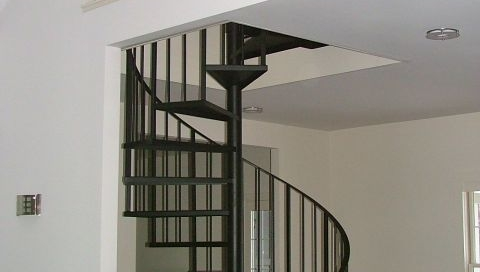 Finelli Architectural Iron and Stairs custom steel spiral staircase with wrought iron treads