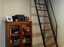 finelli ironworks handmade custom natural iron and cherry wood interior library style ladder in downtown cleveland ohio