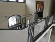 finelli ironworks custom handmade interior iron and glass landing railing in columbus ohio