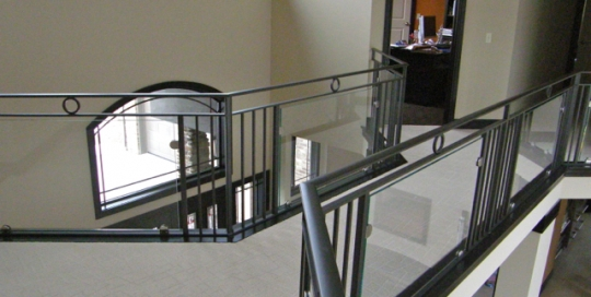 finelli ironworks custom handmade interior iron and glass landing railing in columbus ohio