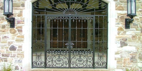 Finelli iron works custom handmade decorative wrought iron metal driveway and man gate in hunting valley ohio